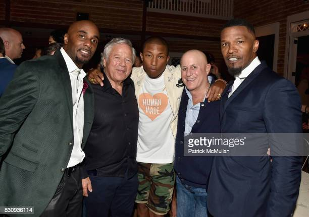 Robert Kraft Pharrell Williams Ronald O Perelman and Jamie Foxx attend Apollo in the Hamptons at The Creeks on August 12 2017 in East Hampton New York