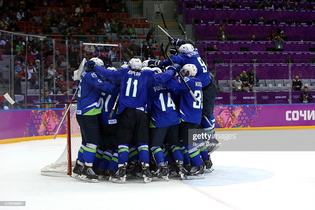 Robert Kristan and Anze Kopitar of Slovenia celebrate with their teammates after defeating Austria 4 to 0 in the Men's Ice Hockey Qualification...