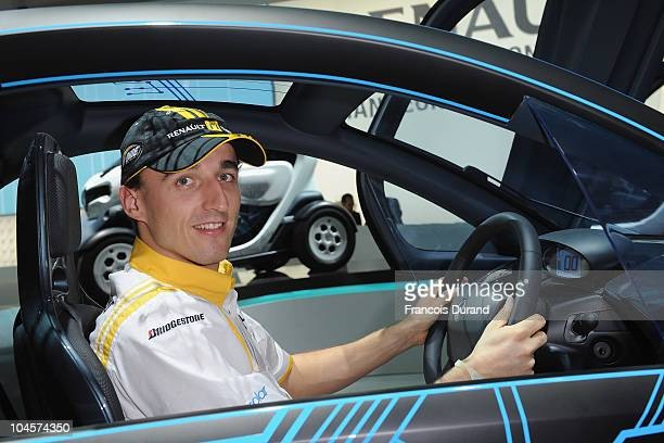 Robert Kubica attends the Renault presentation of the Cannes Film Festival Official Car 'Latitude' during the 2010 Paris motor show at the Parc des...