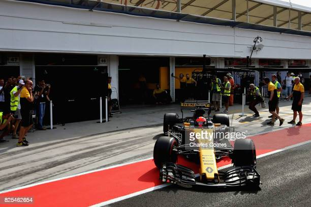 Robert Kubica driving the Renault Sport Formula One Team Renault RS17 in the Pitlane during day two of F1 in season testing at Hungaroring on August...