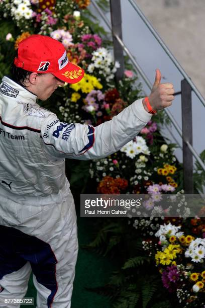 Robert Kubica Grand Prix of Malaysia Sepang International Circuit 23 March 2008 Robert Kubica on the winners podium of the 2008 Grand Prix of...