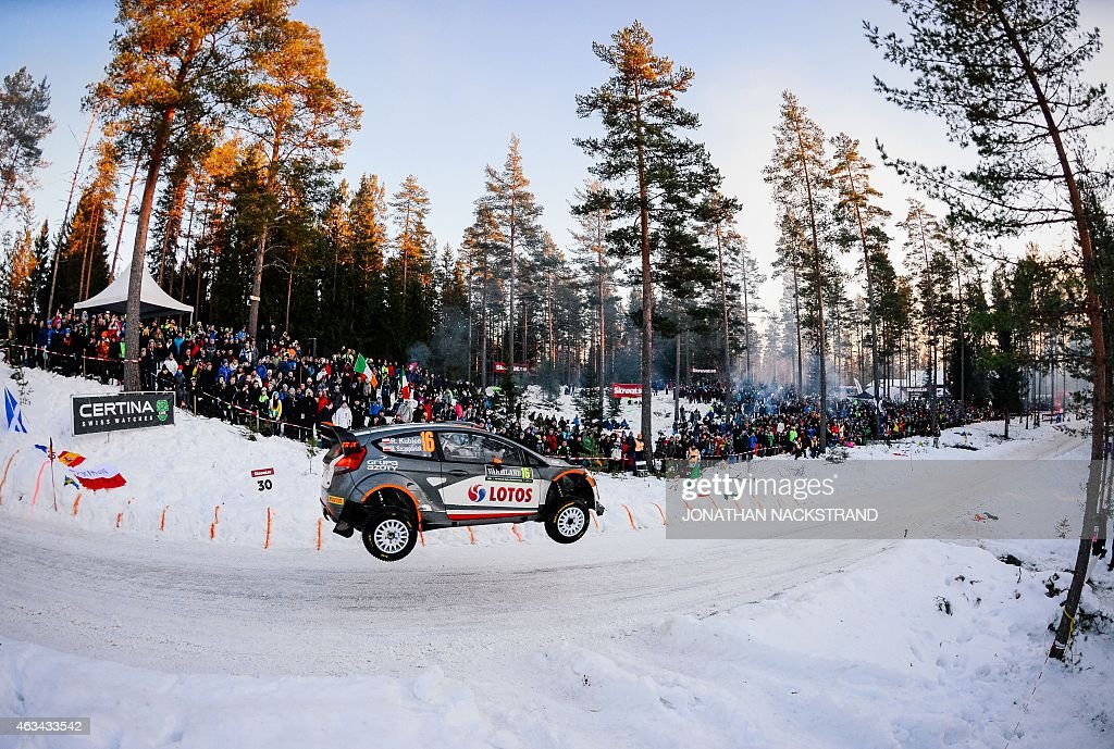 Robert Kubica of Poland and his codriver Maciej Szczepaniak steer their Ford Fiesta WRC during the 18th stage of the Rally Sweden second round of the...