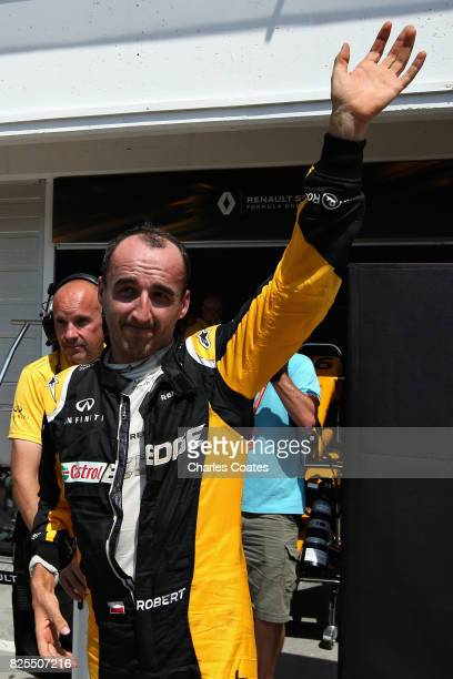 Robert Kubica of Poland and Renault Sport F1 waves to the crowd from the pit lane during day two of F1 in season testing at Hungaroring on August 2...
