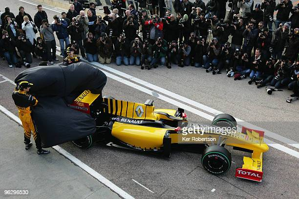 Robert Kubica of Poland and Vitaly Petrov of Russia unveil the new Renault R30 at the Ricardo Tormo circuit on January 31 2010 in Valencia Spain