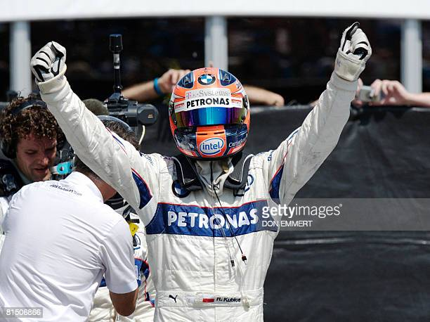 Robert Kubica of Poland driving for BMW Sauber celebrates his victory in the Canadian Formula One Grand Prix June 8 2008 in Montreal AFP PHOTO/DON...