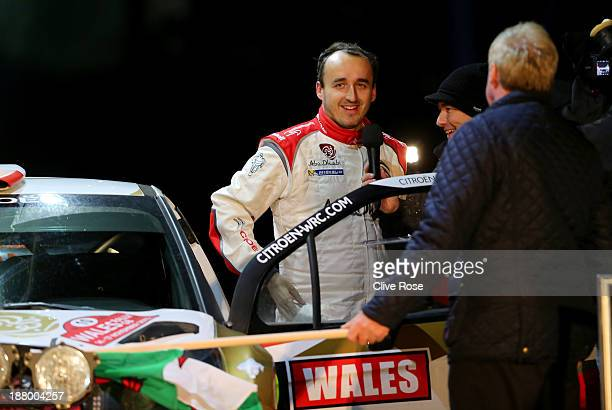 Robert Kubica of Poland is interviewed during the ceremonial start of the FIA World Rally Championship Great Britain on November 14 2013 in Conwy...
