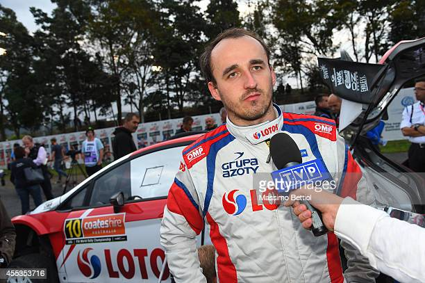 Robert Kubica of Poland talks to the media during Day Two of the WRC Australia on September 13 2014 in Coffs Harbour Australia