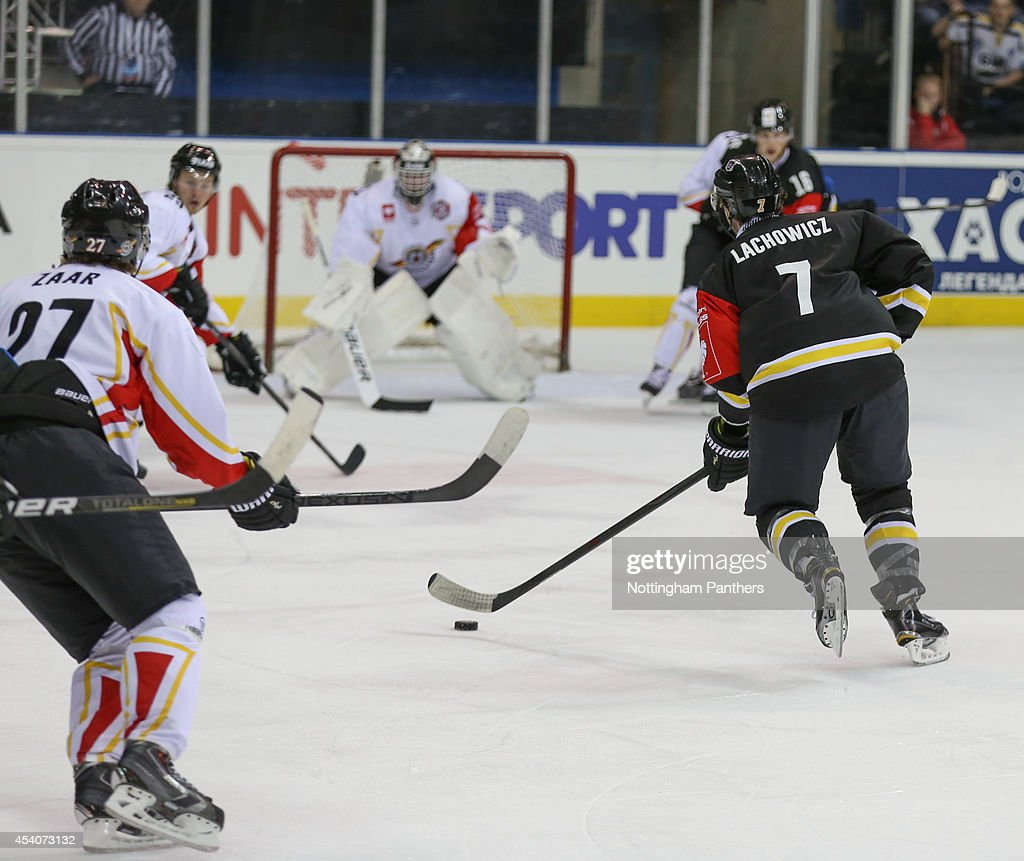 Robert Lachowicz #7 of Nottingham Panthers prepares to shoot during the Champions Hockey League group stage game between Nottingham Panthers and Lulea Hockeyat at the National Ice Centre on August 24, 2014 in Nottingham, England.