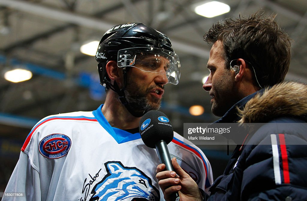 Robert Leask of Thomas Sabo Ice Tigers is interviewed during the DEL match between EHC Red Bull Muenchen and Thomas Sabo Ice Tigers at Olympia Eishalle on March 1, 2013 in Munich, Germany.