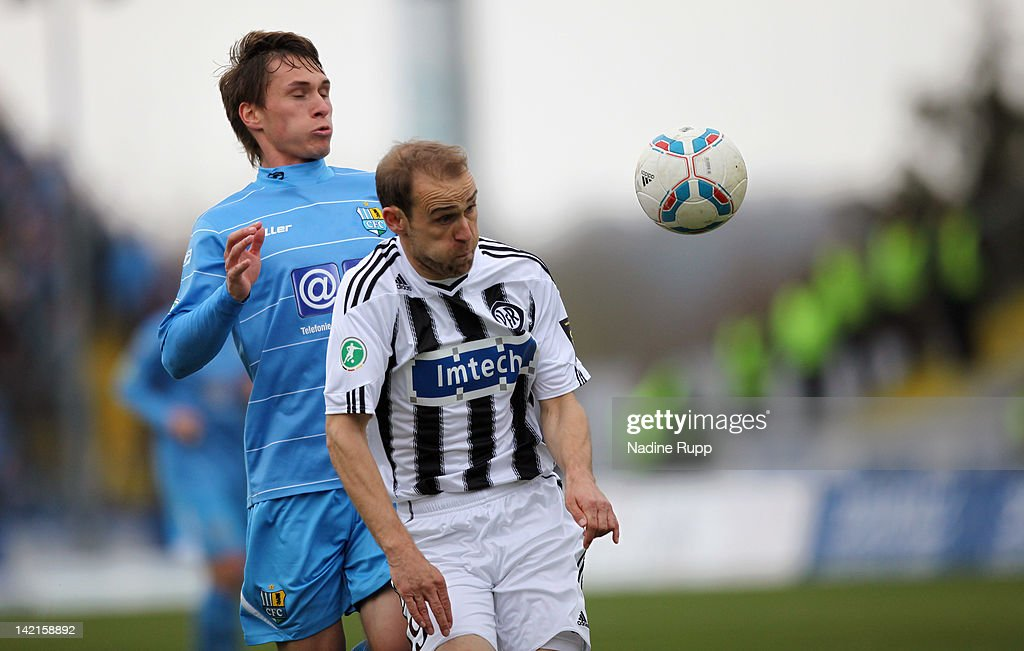 Robert Lechleiter of Aalen battles for the ball with Thomas Birk of Chemnitz during the Third League match between VfR Aalen and Chemnitzer FC at...