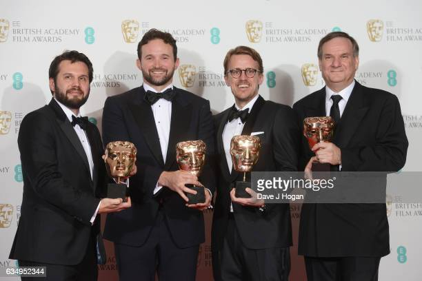 Robert Legato Dan Lemmon Andrew R Jones and Adam Valdez pose with their awards for Special Visual Effects for 'The Jungle Book' in the winners room...