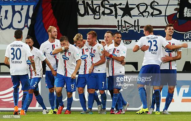 Robert Leipertz of Heidenheim celebrates his team's fourth goal with team mates during the Second Bundesliga match between 1 FC Heidenheim and 1 FC...