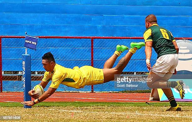 Robert Leota of Australia dives to score a try during the Rugby Sevens Men's Final match between Australia and South Africa at the Apia Park Sports...
