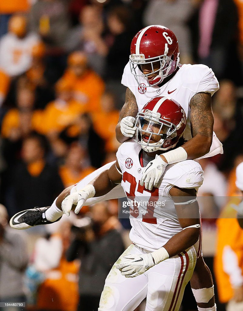 Robert Lester #37 of the Alabama Crimson Tide reacts after intercepting a touchdown reception intended for Alton Howard #2 of the Tennessee Volunteers with Ha'Sean Clinton-Dix #6 at Neyland Stadium on October 20, 2012 in Knoxville, Tennessee.