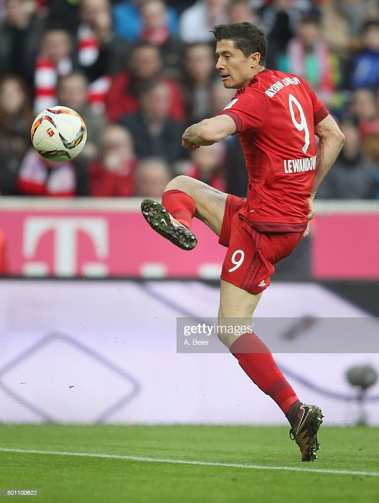 Robert Lewandoski of Bayern Muenchen plays the ball during the Bundesliga match between FC Bayern Muenchen and FC Ingolstadt at Allianz Arena on December 12, 2015 in Munich, Germany.