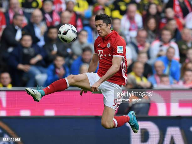 Robert Lewandowksi of FC Bayern Muenchen controls the ball during the Bundesliga match between Bayern Muenchen and Borussia Dortmund at Allianz Arena...