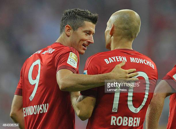 Robert Lewandowski and Arjen Robben of FC Bayern Muenchen celebrate scoring their team's second goal during the Bundesliga match between FC Bayern...