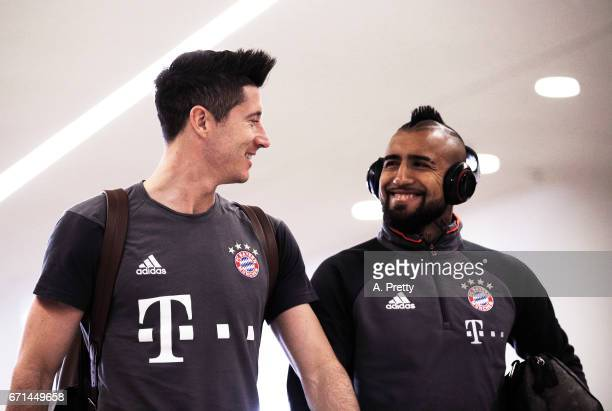 Robert Lewandowski and Arturo Vidal of Bayern Munich arrive for the Bundesliga match between Bayern Muenchen and 1 FSV Mainz 05 at Allianz Arena on...