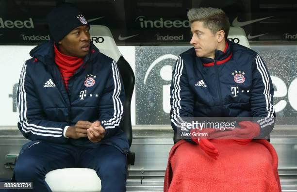 Robert Lewandowski and David Alaba of Muenchen sit on the bench prior to the Bundesliga match between Eintracht Frankfurt and FC Bayern Muenchen at...