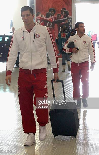 Robert Lewandowski and Juan Bernat of Bayern Muenchen arrive for the Bundesliga match between FC Bayern Muenchen and 1899 Hoffenheim at Allianz Arena...