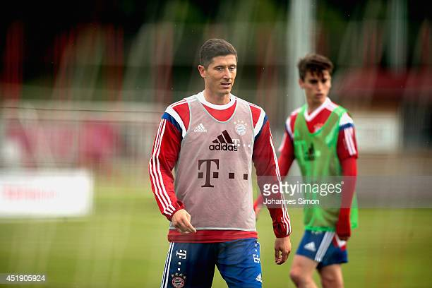 Robert Lewandowski and Lucas Scholl of Bayern Muenchen attend a training session at Bayern`s trainings ground Saebener strasse on July 9 2014 in...