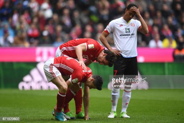 Robert Lewandowski and Mats Hummels of Bayern Muenchen talk to each other during the Bundesliga match between Bayern Muenchen and 1 FSV Mainz 05 at...