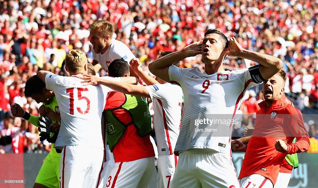 Robert Lewandowski and Poland players celebrate their win infront of the Switzerland supporters after the UEFA EURO 2016 round of 16 match between...
