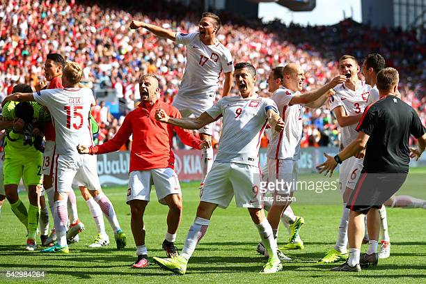 Robert Lewandowski and Poland players celebrate their win with their supporters after the UEFA EURO 2016 round of 16 match between Switzerland and...