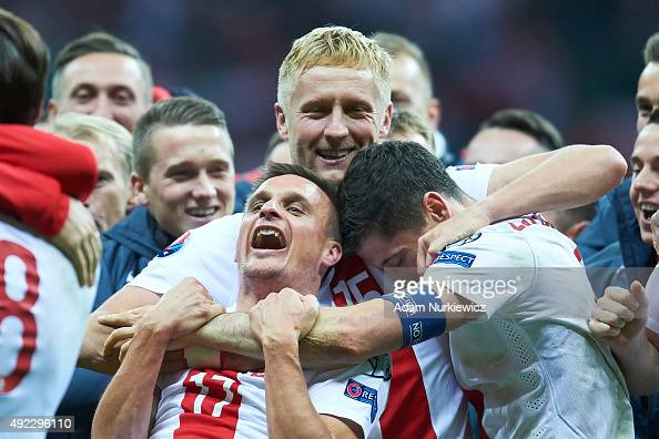 Robert Lewandowski and Slawomir Peszko and Kamil Glik all from Poland celebrate after the UEFA EURO 2016 qualifying match between Poland and Republic...