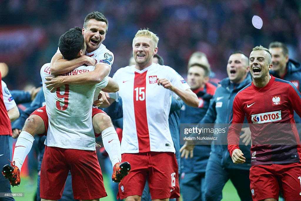 Robert Lewandowski and Slawomir Peszko and Kamil Glik and Kamil Grosicki all from Poland celebrate after the UEFA EURO 2016 qualifying match between Poland and Republic of Ireland at National Stadium on October 11, 2015 in Warsaw, Poland.