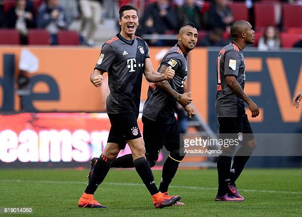Robert Lewandowski Arturo Vidal and Douglas Costa of Bayern Munich celebrate after scoring a goal during the Bundesliga soccer match between FC...