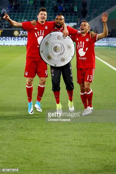 Robert Lewandowski Arturo Vidal and Rafinha of Bayern celebrate after winning the German Championship after winning 60 the Bundesliga match between...