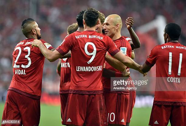 Robert Lewandowski Arturo Vidal Arjen Robben and Douglas Costa of Munich celebrate a goal during the German Bundesliga soccer match between Bayern...