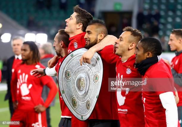 Robert Lewandowski Arturo Vidal Rafinha and Douglas Costa of Muenchen celebrate after the Bundesliga match between VfL Wolfsburg and Bayern Muenchen...
