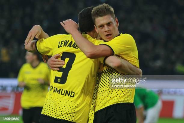 Robert Lewandowski cellebrates the first goal with Lukasz Piszczek of Dortmund during the Bundesliga match between Borussia Dortmund and Hannover 96...