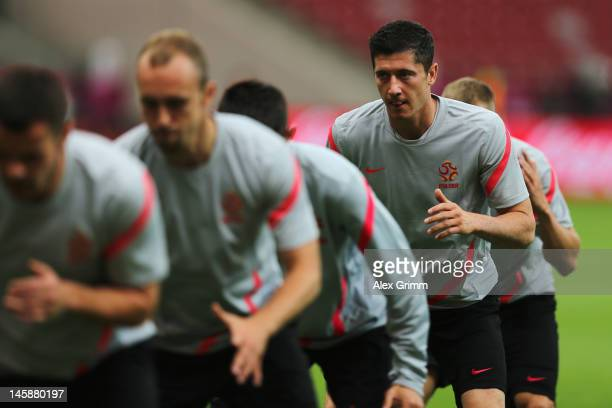 Robert Lewandowski exercises during a Poland training session ahead of the UEFA EURO 2012 Group A match against Greece at National Stadium on June 7...