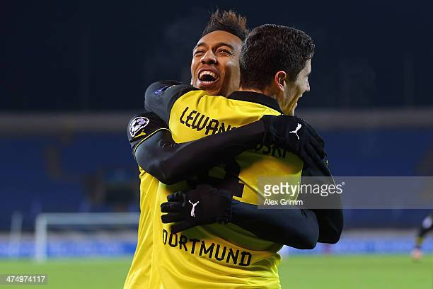 Robert Lewandowski f Dortmund celebrates his team's third goal with team mate PierreEmerick Aubameyang during the UEFA Champions League Round of 16...