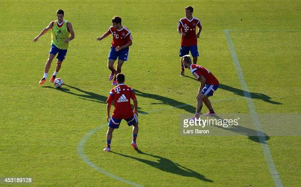 Robert Lewandowski is challenged by four team mates during a Bayern Muenchen training session at day six of the Audi Summer Tour USA 2014 on August 4...