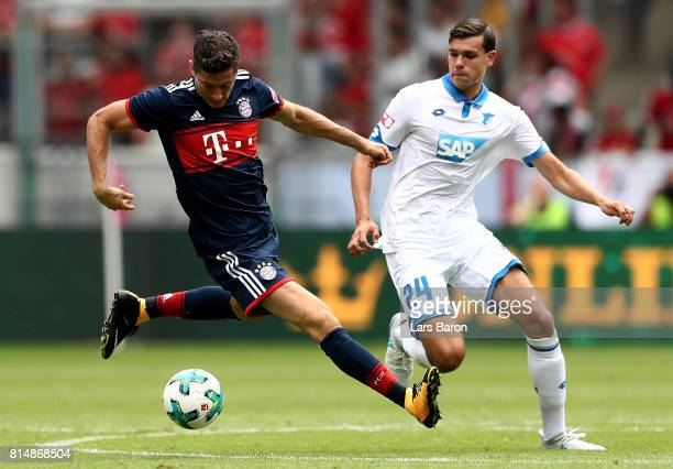 Robert Lewandowski is challenged by Justin Hoogma of Hoffenheim during the Telekom Cup 2017 match between Bayern Muenchen and 1899 Hoffenheim at on...