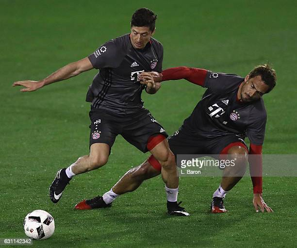 Robert Lewandowski is challenged by Mats Hummels during a training session at day 5 of the Bayern Muenchen training camp at Aspire Academy on January...