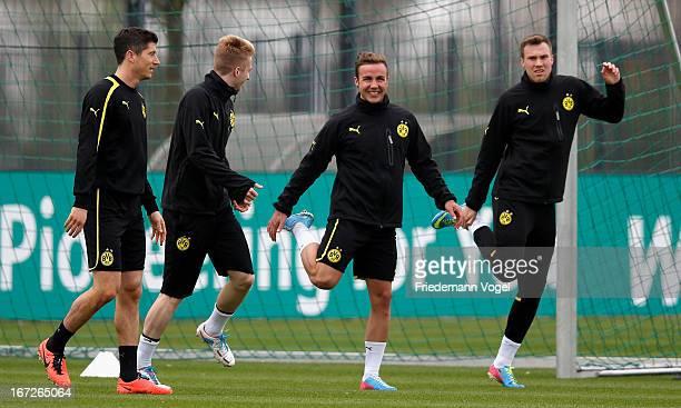 Robert Lewandowski Marco Reus Mario Goetze and Kevin Grosskreutz warm up during a Borussia Dortmund training session ahead of their UEFA Champions...