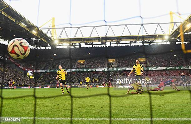 Robert Lewandowski o Muenchen heads his teams first goal during the Bundesliga match between Borussia Dortmund and FC Bayern Muenchen at Signal Iduna...