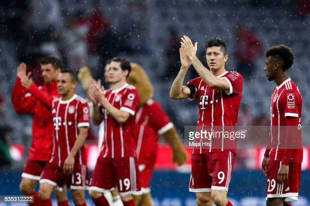 Robert Lewandowski of Bayern and the team react after the Bundesliga match between FC Bayern Muenchen and Bayer 04 Leverkusen at Allianz Arena on...