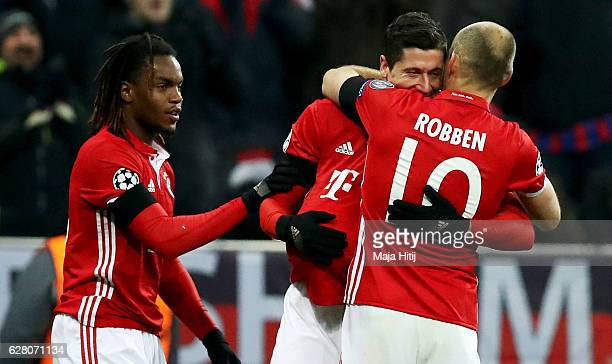 Robert Lewandowski of Bayern celebrate with team mate Arjen Robben after he scores the opening goal during the UEFA Champions League match between FC...