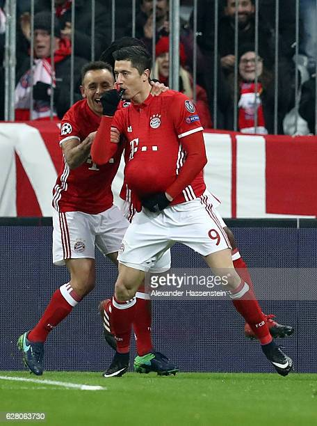 Robert Lewandowski of Bayern celebrate with team mate Rafinha after he scores the opening goal during the UEFA Champions League match between FC...