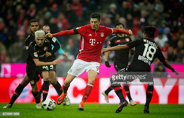 Robert Lewandowski of Bayern fights for the ball with Kevin Kampl Wendell of Leverkusen during the Bundesliga match between Bayern Muenchen and Bayer...