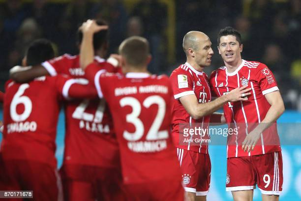Robert Lewandowski of Bayern Muenchen and Arjen Robben of Bayern Muenchen celebrate their third goal to make it 03 during the Bundesliga match...