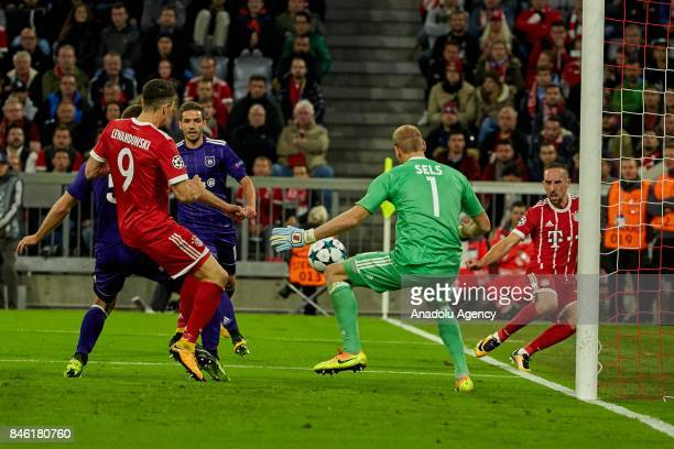 Robert Lewandowski of Bayern Muenchen and goalkeeper Matz Sels of Anderlecht battle for the ball during the UEFA Champions League group B match...