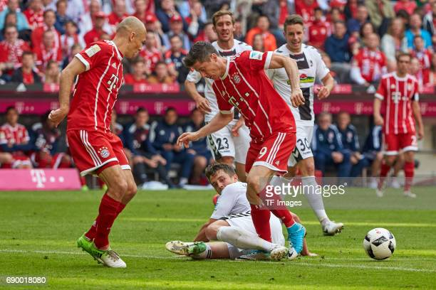 Robert Lewandowski of Bayern Muenchen and MarcOliver Kempf of Freiburg battle for the ball during the Bundesliga match between Bayern Muenchen and SC...