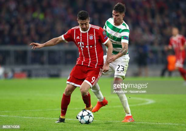 Robert Lewandowski of Bayern Muenchen and Mikael Lustig of Celtic in action during the UEFA Champions League group B match between Bayern Muenchen...